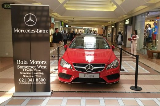 """This red Mercedes-Benz E-Class has been rather popular amongst shoppers. You could say, """"this powerful lady dressed in red has turned a view heads""""."""