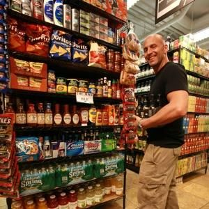 """SHOP RIGHT: Bill Pelowitz stocks up on essentials yesterday in """"The Man Isle"""" at Westside Market."""