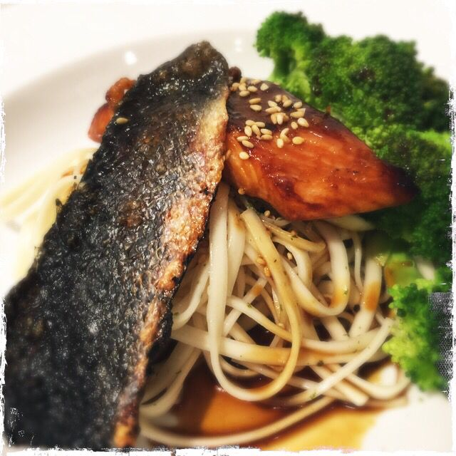 Mirin-glazed salmon with oven-baked crispy salmon skin over a bed of Shanghai flat noodles.