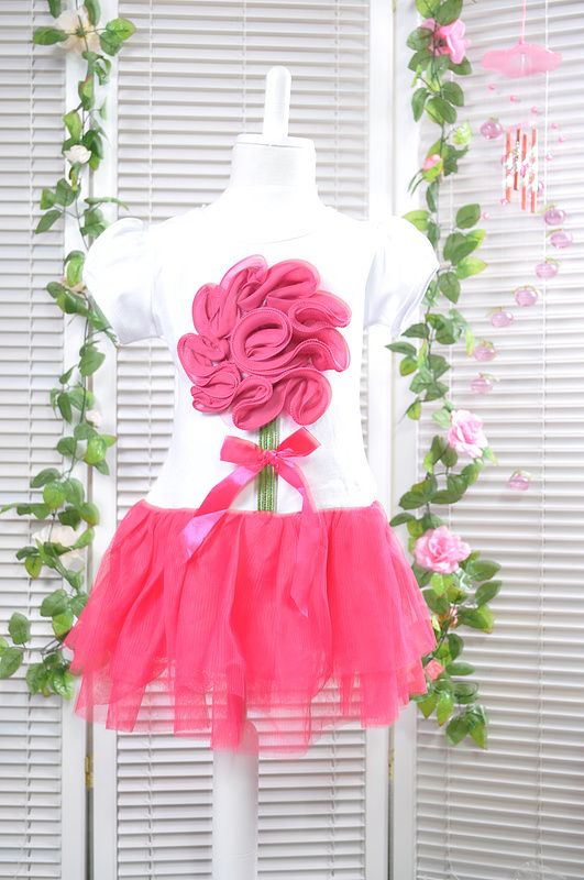 Cotton dress decorated with lollipop/ flower design and pink tulle skirt.