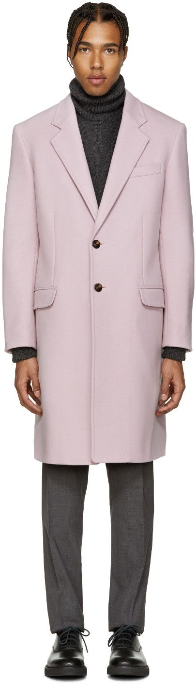 Long sleeve wool coat in 'lilac' pink. Notched lapel collar. Two-button closure at front. Welt and flap pockets at body. Single-button cuffs. Vent at back. Welt pockets at fully lined interior. Tonal lining featuring signature Medusa head print. Tonal stitching