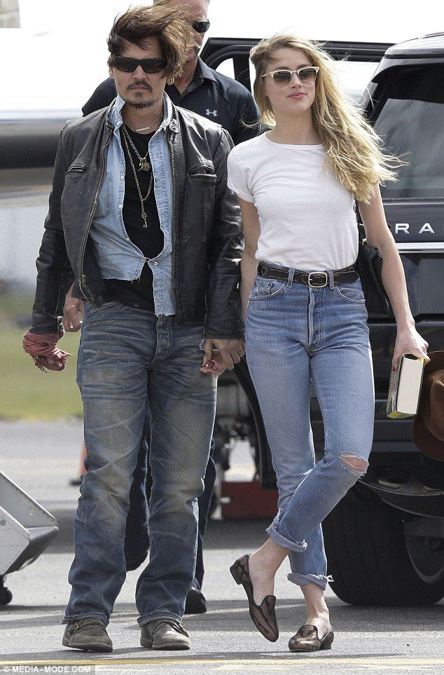 Trouble with the law: Johnny Depp's wife Amber Heard has been charged with illegally importing her two dogs into Australia on a private jet