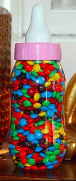 Fill the bottle with treats. Have guests guess how many there are. Who ever is the closest takes the treat home.