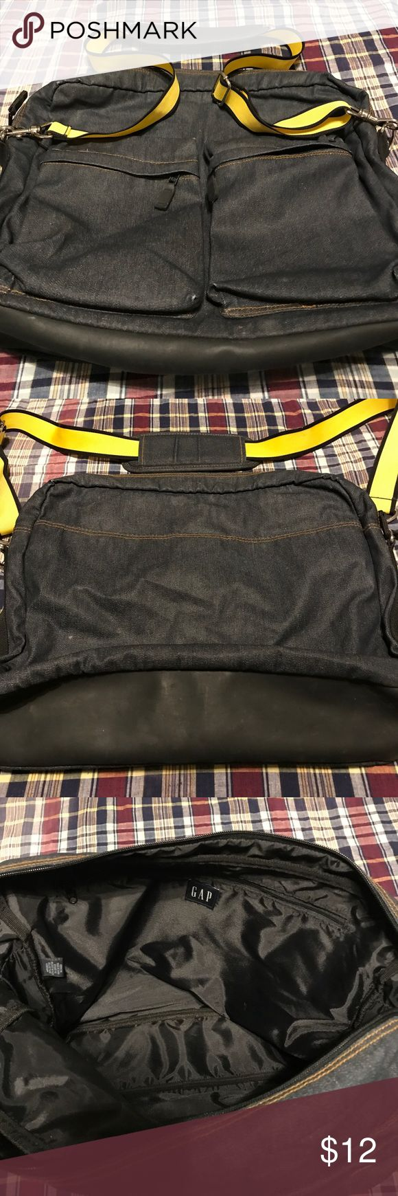 """GAP dark denim crossbody (large) bag, purse/laptop EUC Gap denim cross body bag or laptop/carryall. Only carried a couple of times, still in excellent condition. Dark denim body, black leather or vinyl bottom (I'm not sure which - the tag doesn't say), silver grommets/hardware and yellow/black adjustable shoulder strap. Large zipper pocket inside and x-large Velcro pocket on back of bag as well as two deep zipper pockets on front of bag. Dimensions are: 17 1/2"""" across, 14"""" top to bottom, 3…"""