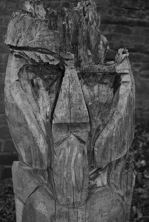 Black and white wooden carving statue Vikings