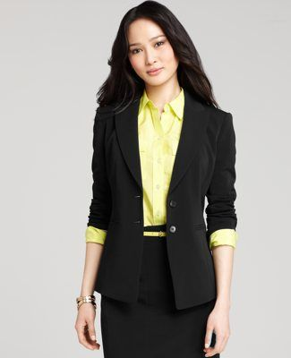 Young? Add a little belt and colored blouse..avoid the caution and warning look of yellow and black for your interview and important meeting days.  Go for this look with pushed up sleeves and a pop of color!