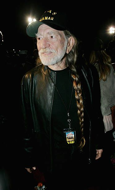 Actor Willie Nelson poses for photographers during a prescreening of the 'Dukes of Hazzard' at MCAS Miramar July 29 2005 in San Diego California