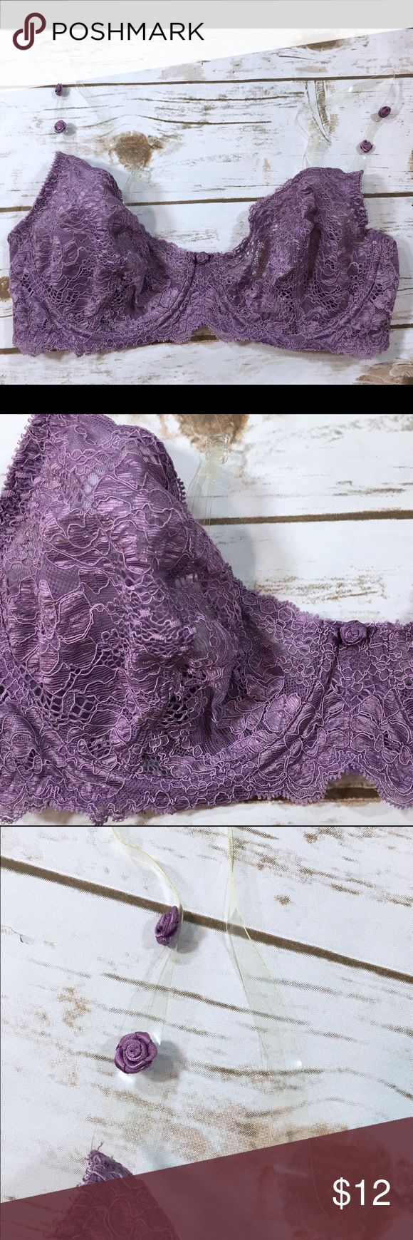 Victoria's Secret Lace Bra w/Clear Straps Victoria's Secret purple lace unlined bra with clear straps. Straps have decorative purple rosettes on them. Bra has underwire, no padding.   Labeled a size 36D.  Very good preowned condition. No holes, stains, or other flaws to note. Victoria's Secret Intimates & Sleepwear Bras