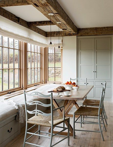 In the breakfast nook at Grey Barn Farm, exposed beams and raw floorboards add to the rustic-modern look | archdigest.com