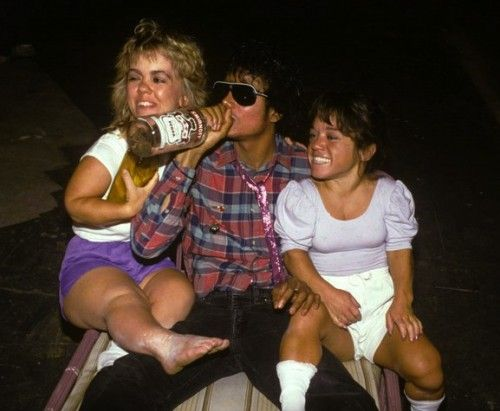Captain EO cast party, circa '85. Michael Jackson isn't actually drinking Vodka, but the photo is real all the same.
