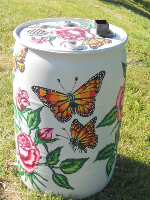 "The Rising Sun is a place of Wisdom & Beauty, this rain barrel is a signature of the Women as Roses whom come here 2 further spread their wings in life:+) Adan Ultrera painted this rain barrel  ""Butterflies and Roses"" for Bluegrass PRIDE's Roll out the Rain Barrel Event"