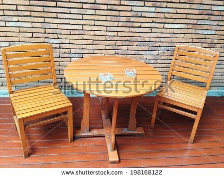 set of wooden table and chairs  by lazybuffy, via Shutterstock