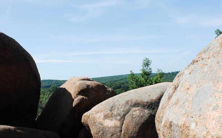 Elephant Rocks State Park (Southeastern MO) | Missouri State Parks :: The giant elephant-shaped granite boulders are the star at Elephant Rocks State Park. The coarsely crystalline red granite forms are popular with history buffs (who like to read the names of the 19th century miners who used to work in the area and who carved their names into rocks), children (who love to climb and scramble over and through the rocks) and parents (who revel in taking pictures of their children pretending to…