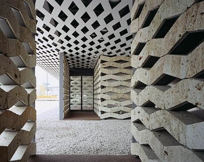 In his signature style, architect Kengo Kuma celebrates material in this innovative design for an exhibition and assembly space in Tochigi, Japan.