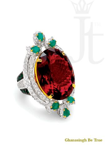 Ring: What stands out as the focus on this limited edition couture piece is a vibrant Tourmaline and Emeralds that highlights the design element. Molded in 18kt gold with diamonds completing it, this ring is a perfect wear for any occasion.| #womensjewelry #beautiful #ring