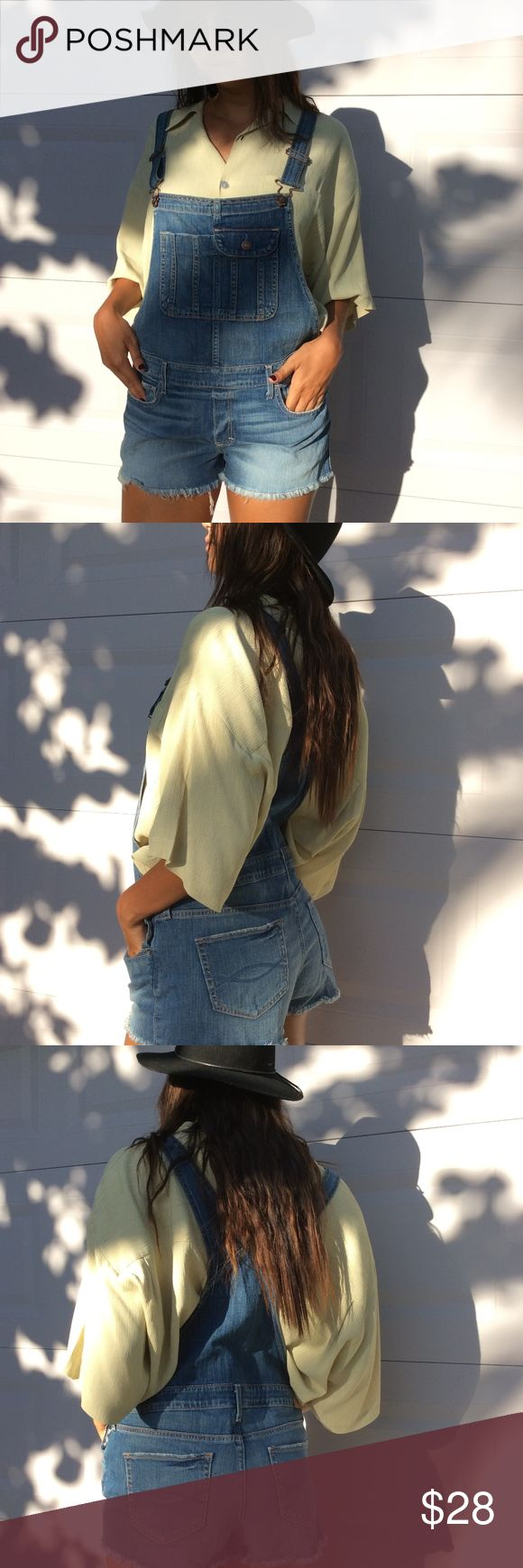 Abercrombie & Fitch Denim Overalls Worn once // cut off shorts with fringe // pockets on the top // it fits amazing! Fits tighter if you have a bigger butt (like me) would fit looser and more of a boyfriend overall if you are smaller like the model :) ~~ worn with oversized green shirt found on my closet~~ Abercrombie & Fitch Jeans Overalls