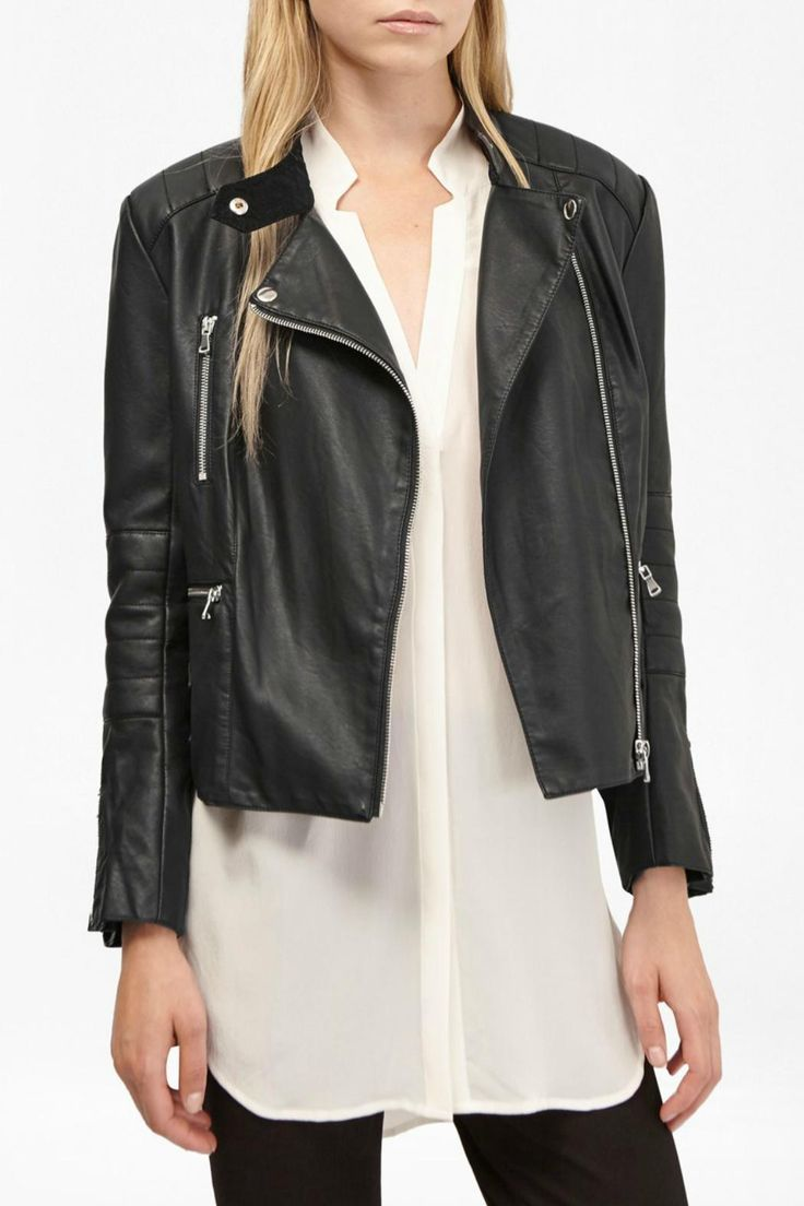 Commit to your inner rebel with this boxy faux-leather cover-up. Featuring multiple zipped pockets, classic biker features and a modern cropped length, it adds cool insouciance to both smart and casual outfits. Cropped faux leather jacket in leather look Biker style Off-centre front zip fastening Long sleeves with elbow quilting and zippers at cuffs Multiple zipped front pockets Collarless with press-stud fastening at neck Boxy fit in cropped length - sits at hip bones    Decade Jacket by…