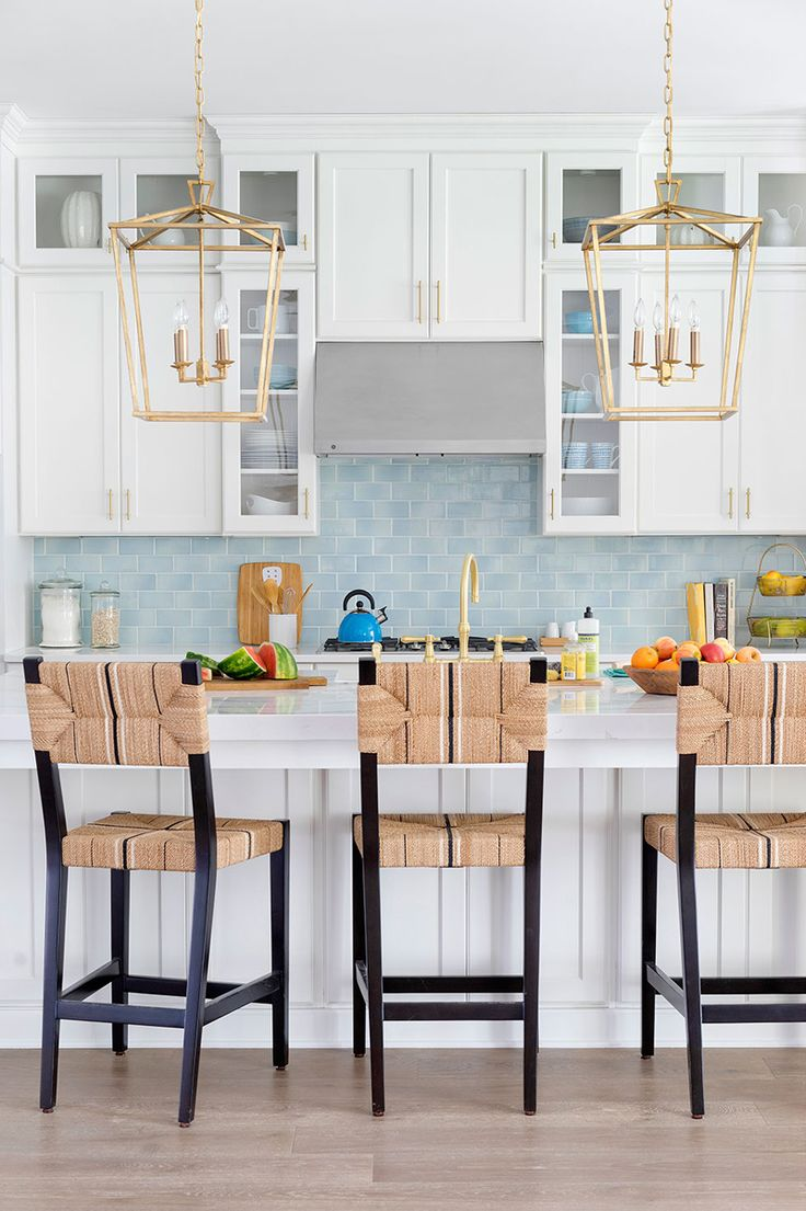 blue backsplash, brass lantern pendants