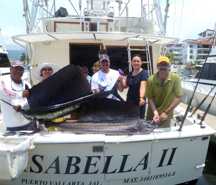 Isabella II with 2 sailfish trophies.