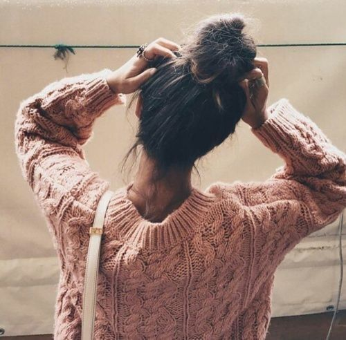 cute and simple messy bun and pink sweater.