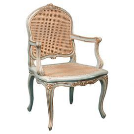 I love this for a feminine office! Mahogany wood accent chair with hand-carved details and a woven cane seat and back.