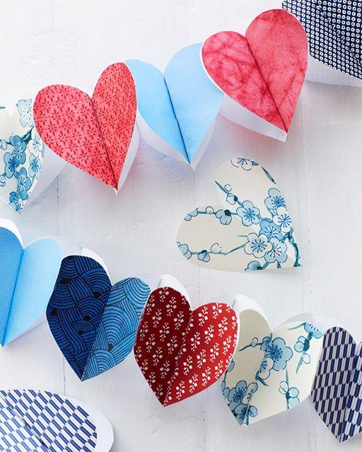 DIY Paper Heart Garland. Pretty for Valentine's Day. #heart #garland #valentinesday