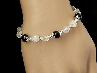 bracelet perles de verre ciselées blanc et rondes noires €5.50