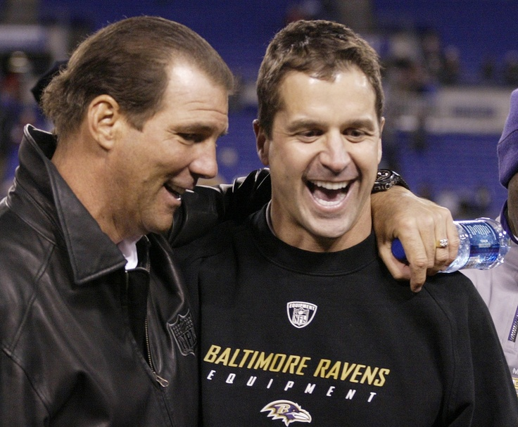 Ravens coach John Harbaugh, a devout Catholic, frequently recites Proverbs 27:17 during team meetings: As iron sharpens iron, so one man sharpens another.     Photo: Baltimore Ravens owner Steve Bisciotti, left, hugs Ravens head coach John Harbaugh (CNS photo/Joe Giza, Reuters)