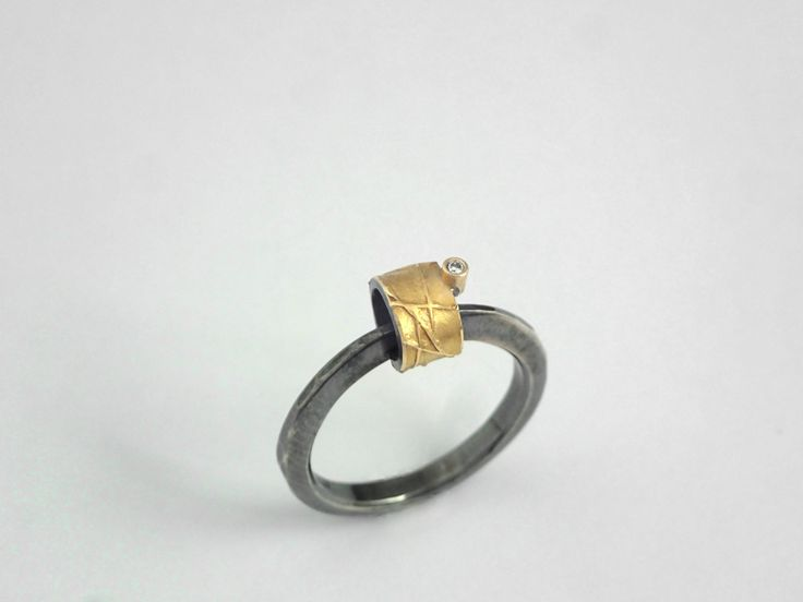 A hobbit's house. Modern gold and oxidized silver ring decorated with a diamond and rough surface. by TomisCraft on Etsy