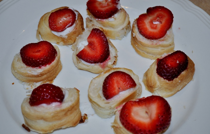 "Indulge in a delicious, yet simple treat. I got this idea from my mom. All you need is a package of ""Cream Horns"" from the grocery store & some fresh strawberries. Slice each cream horn into 6-8 pieces & top with a slice of strawberry. I took these to serve at our league's tennis match today & everyone wanted to know who made them & how."