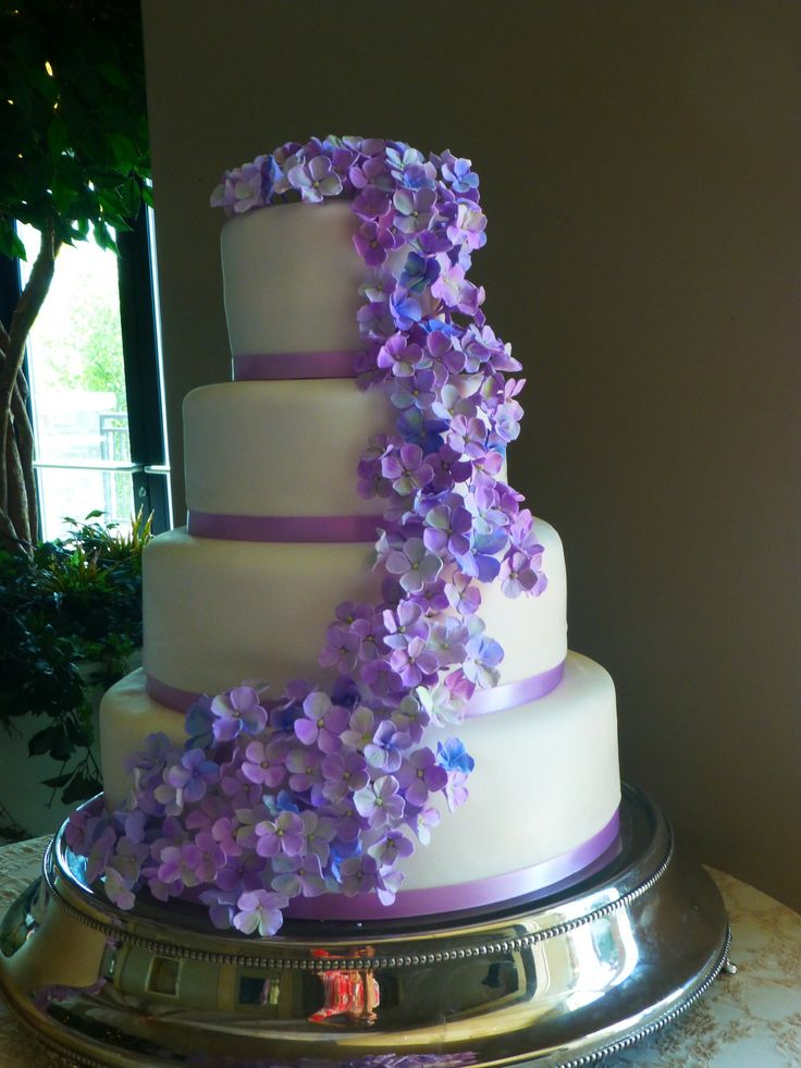 Round wedding cake with purple and periwinkle floral details. http://www.carriescakes.com/
