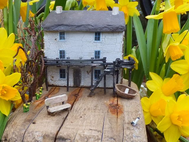 """""""Dylan Thomas' Boathouse"""".  Handmade in Wales using driftwood from Pendine Beach, West Wales together with other reclaimed materials, including Welsh slate."""