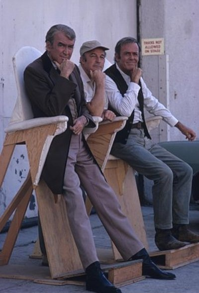 "Jimmy Stewart, Gene Kelly and Henry Fonda on the set of ""The Cheyenne Social Club"" (1970)"