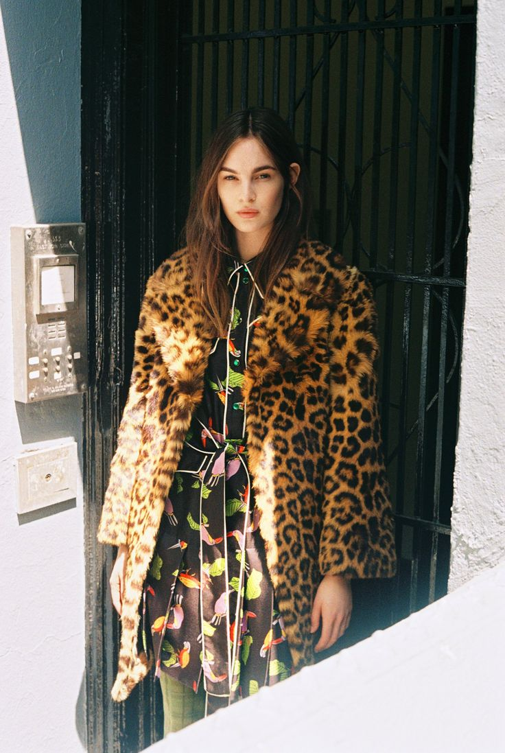 Laura Love in a vintage leopard coat, Gucci toucan print shirtdress, and tights