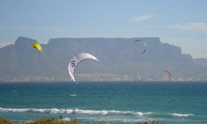 A beautiful sight in Blouberg - all the colourful kites flying above the water