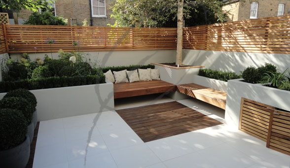 Wooden benches, corner tree and storage in planter