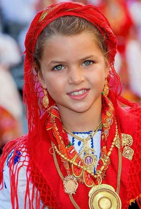 Palestine - child, girl, in traditional dress.