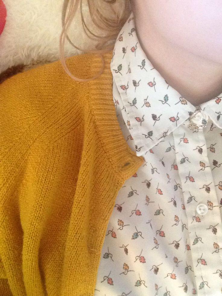 mustard cardigan on print shirt.