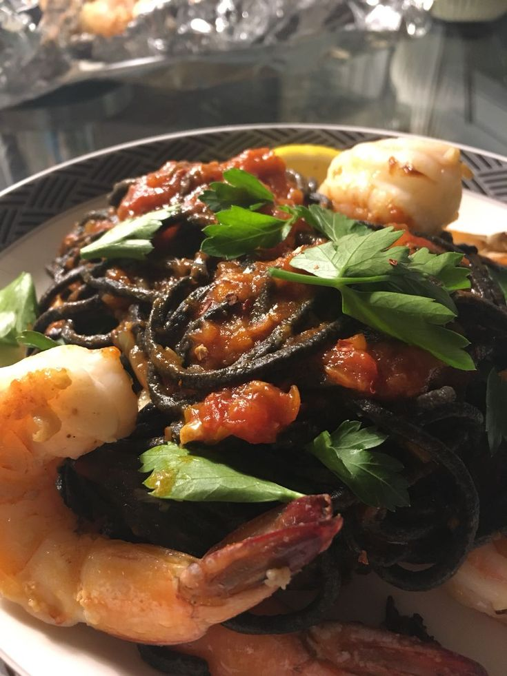 [Homemade] Squid ink pasta with sauteed shrimp arrabbiata sauce and fresh parsley! http://ift.tt/2j96he8