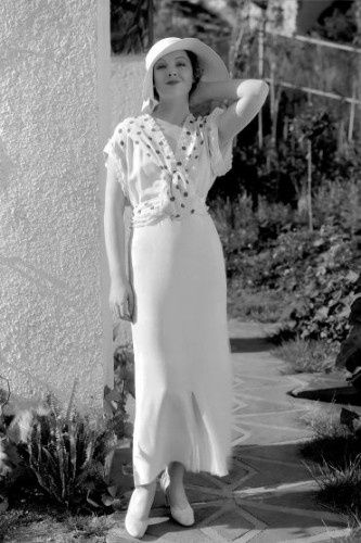 Polka Dot Dresses: Myrna Loy in When Ladies Meet (1933) sporting a more casual dress with polka dot trim.