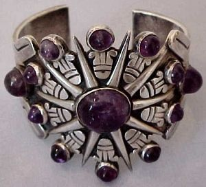 Cuff |  William Spratling. 'Aztec Sunburst'.  Sterling silver with amethysts.  ca. 1931 -46.