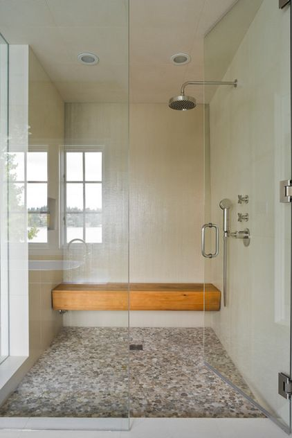 Floating bench. A floating bench is firmly secured to the shower walls but is open underneath. It can be made of waterproofed wood, like this one.