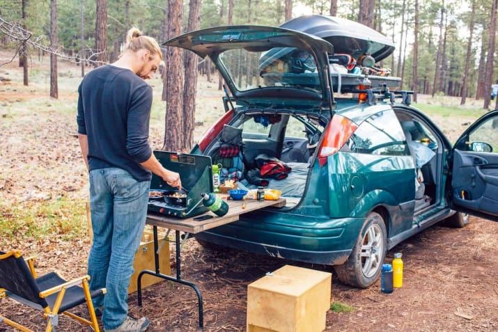 It just needs to have legs the same height as your car's bumper. Get more tips and learn how to pack a functional car camping pantry and kitchen on Fresh Off the Grid.