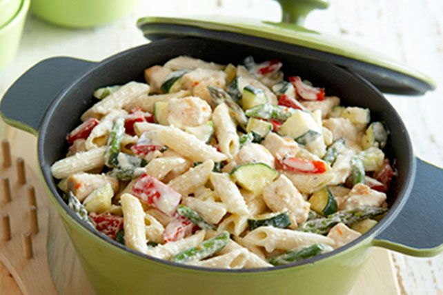 Fresh zucchini and asparagus team up with penne pasta, chicken and two kinds of cheese for a delicious way to get some veggies on the table.