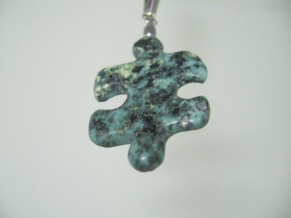 My pendants are made by hand. For my Autism Awareness Pendant line, each hand selected rock is cut into slabs and puzzle pieces are traced onto them. Each shape is cut out, roughly then finely shaped, and meticulously polished. Hours of work go into each piece and they are completely stunning! Each work of art is truly one-of-a-kind! Paste this link into your browser to glimpse at how I make them! http://resonatedrock.com/2012/02/16/raising-autism-awareness-2&#x2...
