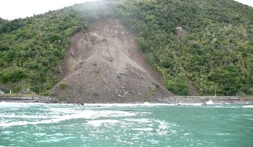 One of many landslides covering the main coastal road on State Highway 1, north/south of Kaikoura.