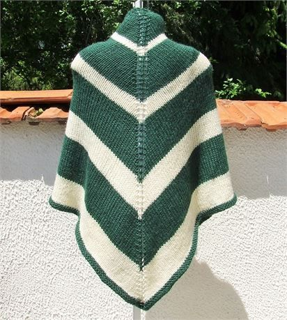 Hand knitted green and cream striped triangle shape shawl / wrap   Lovely soft shawl knitted in a soft alpaca mix yarn - Triangle shape - knitted in stocking stitch    Size - (approx - unstretched) 35 (89 cm) length x 68 (172cm) width at top    Material - 25% alpaca 35% wool 40% acrylic   Colours may appear different on different monitors - Please use zoom feature for a closer view of colour