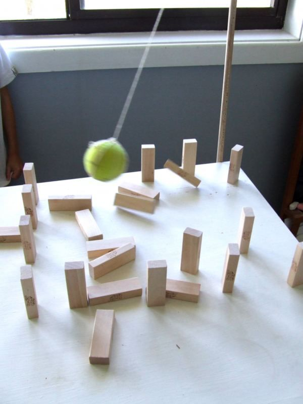 fun activity with tennis ball and blocks... In the last school we had a game like this. You could pull on strings and every stone stood up again, would love to have one again.