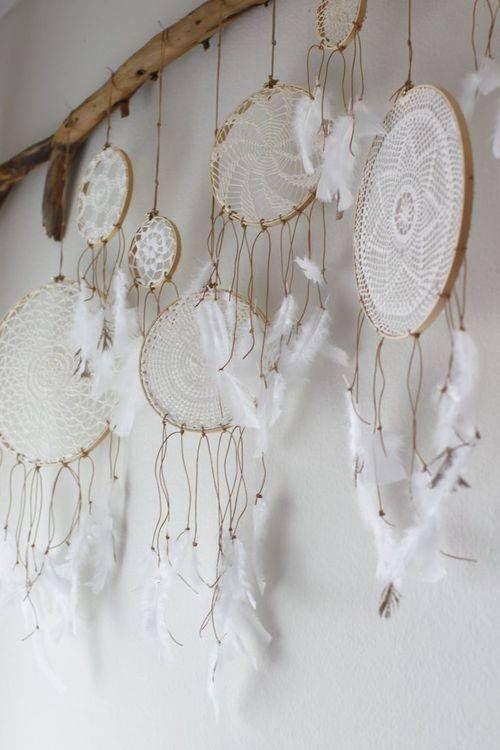 ☯ DIY doily dream catcher wall hanging. It's beautiful, I just wish there was a tutorial on how to make them.