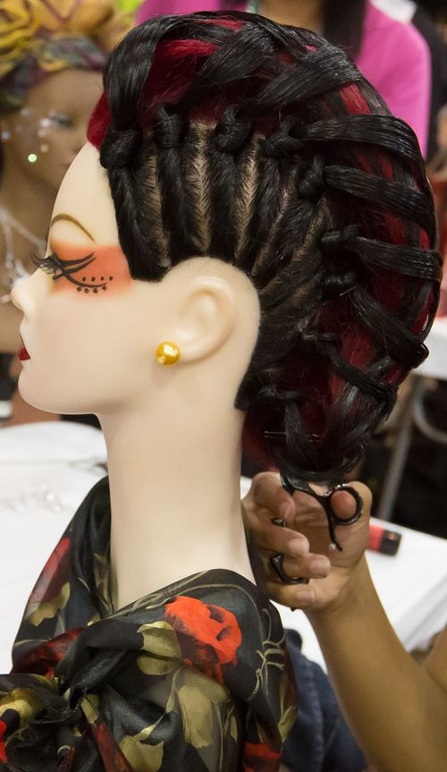 This twisted faux hawk design was created by Maria Chapman, a competitor at Empire's Future Pro Expo 2013.  Maria competed in the Long Hair Evening Design category.  She attends Empire Beauty School in Bordentown, NJ.#fauxhawk